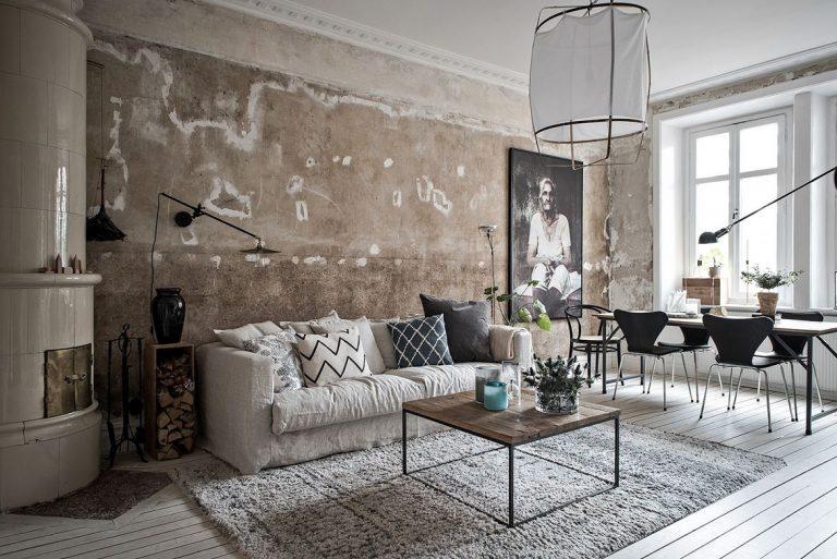 Het industrieel behang maakt deze woonkamer uniek for Wall e deco vendita on line