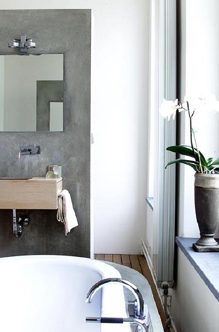 Badkamer met betonnen afwerking