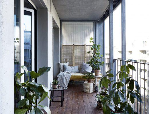 Balkon met een knus industrieel tintje
