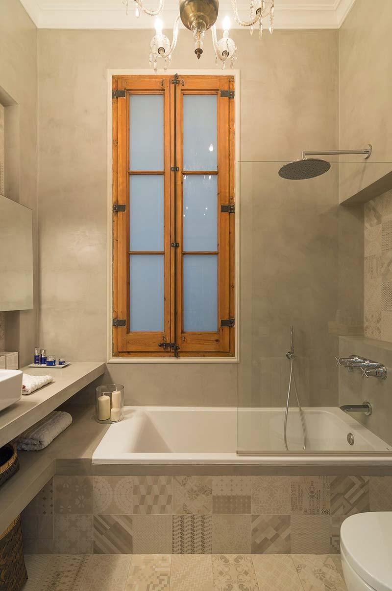 beton cire patchwork tegels kleine badkamer