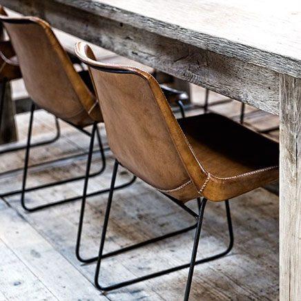 Bruine leren eetkamerstoel inrichting for Eettafel stoelen cognac