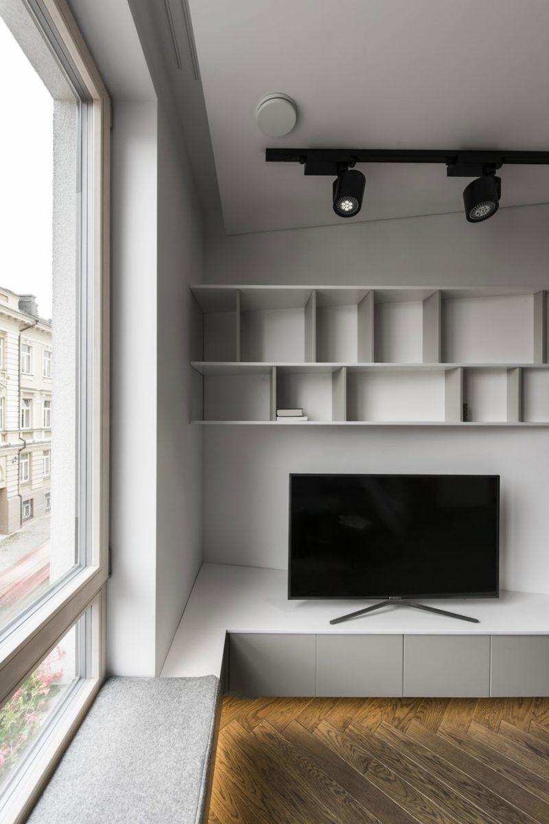 Een op maat gemaakte kast voor woonkamer met schuine muren