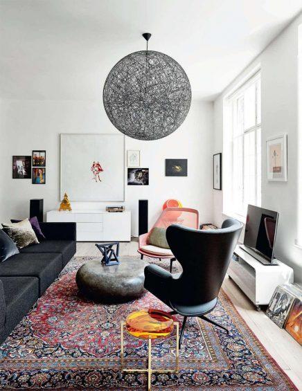 Glazen muur met industrieel kozijn in woonkamer | Inrichting-huis.com
