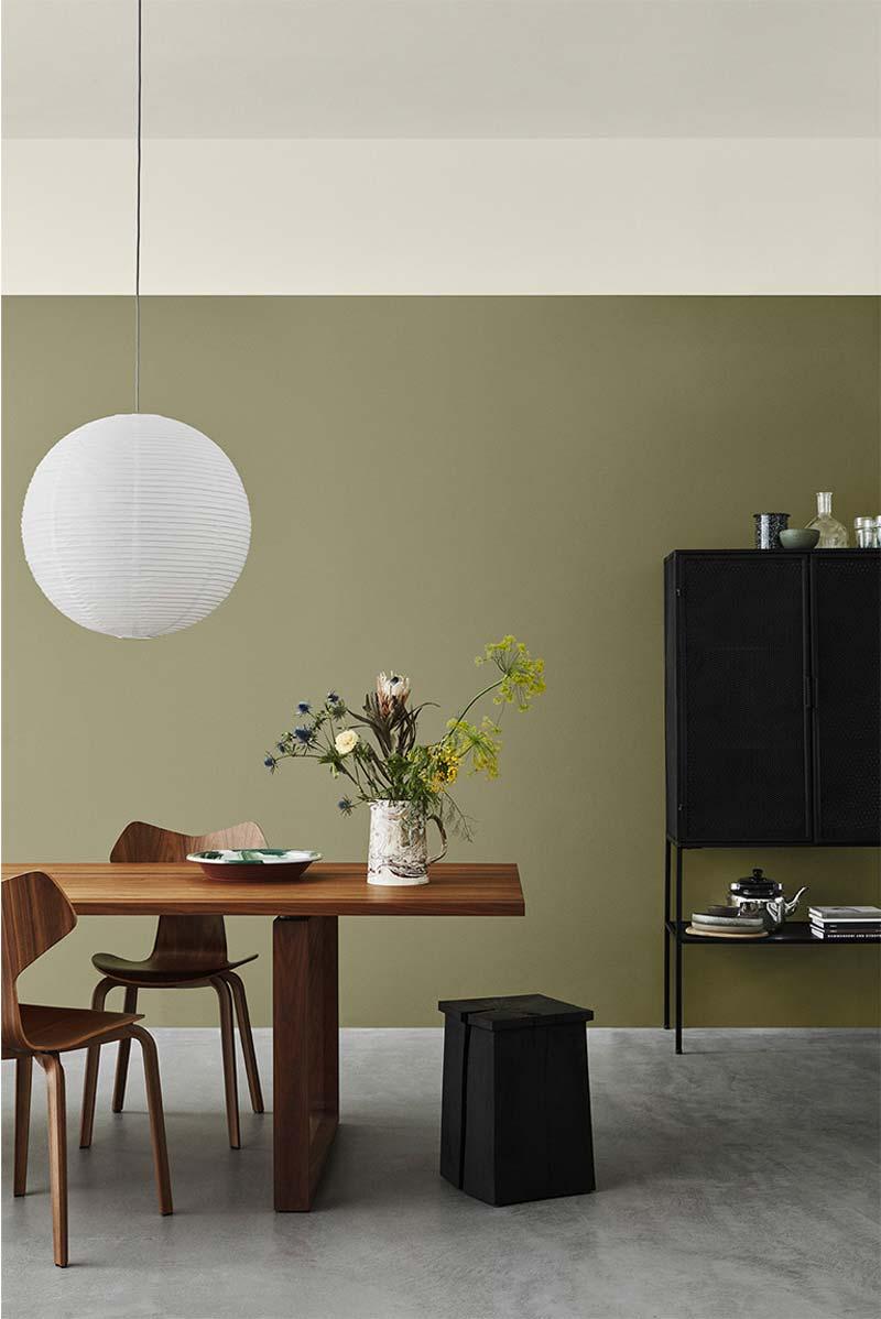 Groen interieur olijfgroene muur
