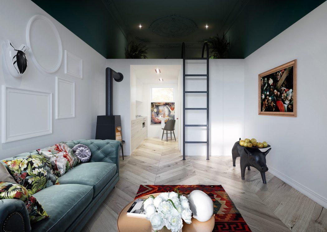De houten vloer met het Hongaarse punt patroon in dit mooie kleine appartement zorgt voor een hele warme uitstraling.
