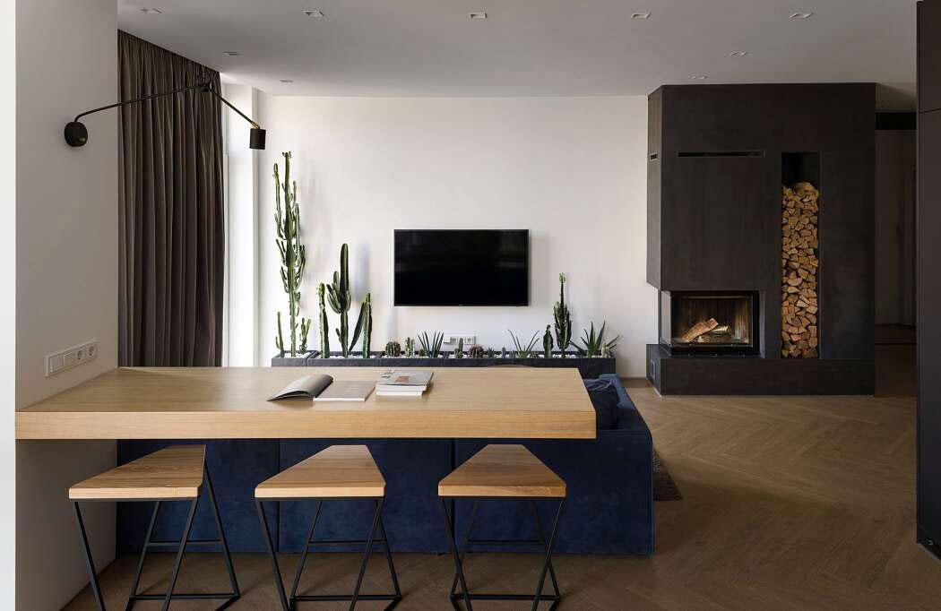 In deze woonkamer hebben ze een plantenbak als TV meubel gebruikt!