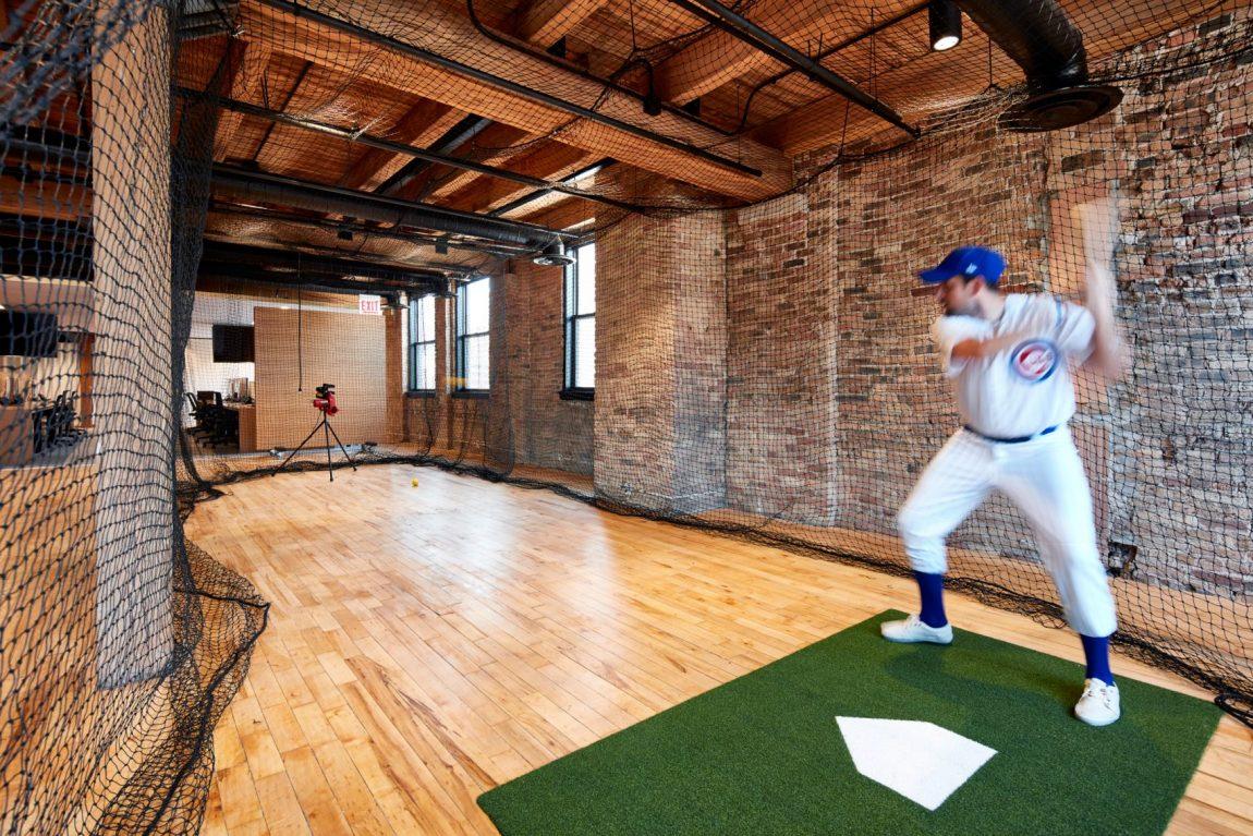 Het industriële kantoor van Ansarada heeft een baseball batting cage
