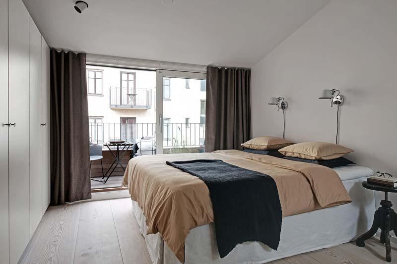 lichte slaapkamer grote kledingkast