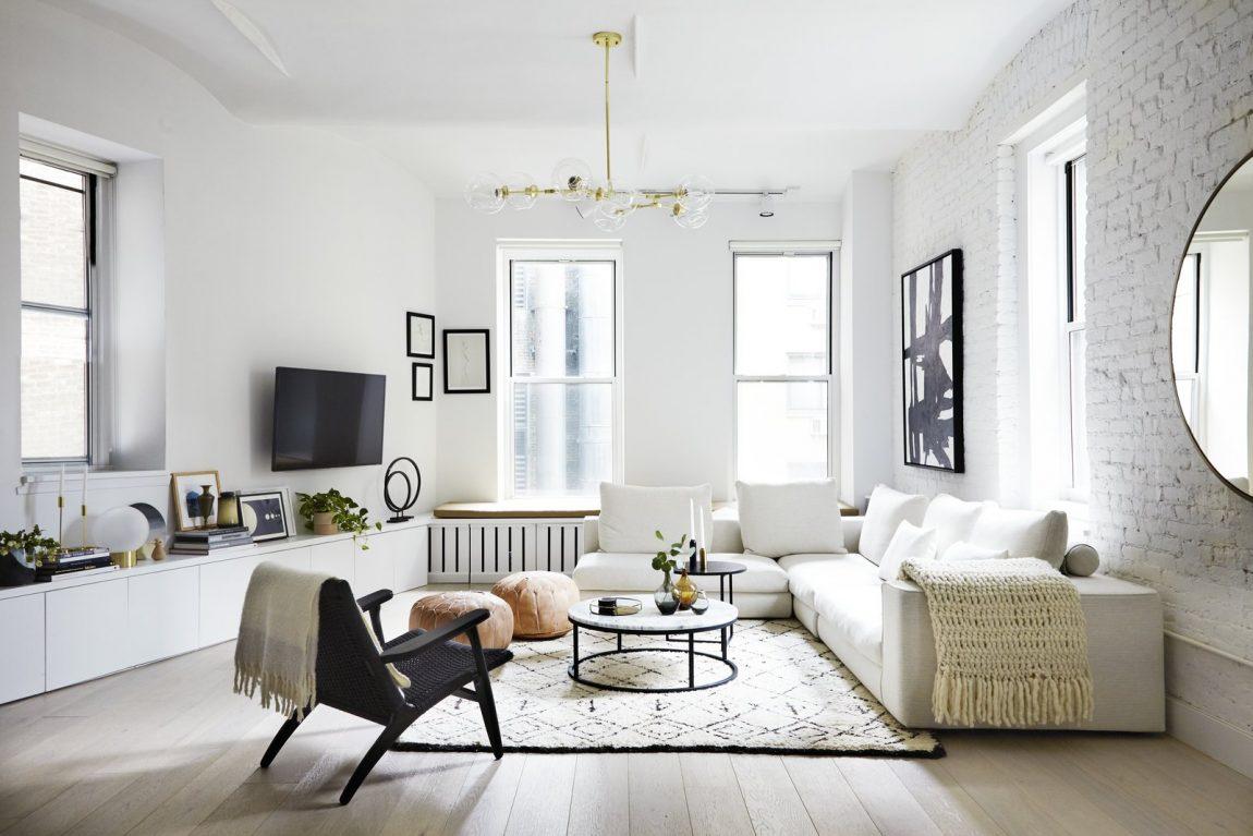 Deze New Yorkse loft woonkamer is ingericht in een mooie Scandinavische stijl