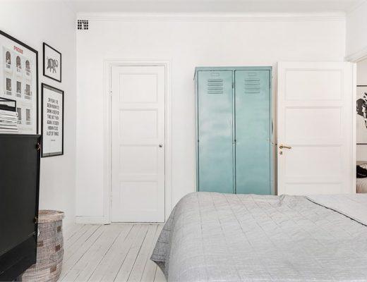 Scandinavische slaapkamer met industriële kasten
