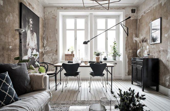 Het industrieel behang maakt deze woonkamer uniek Woonkamer industrieel
