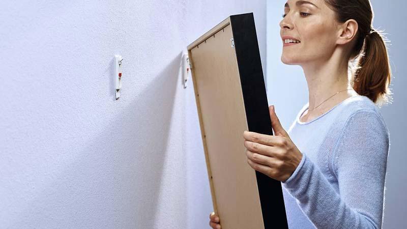 schilderij ophangen zonder boren klevende spijker