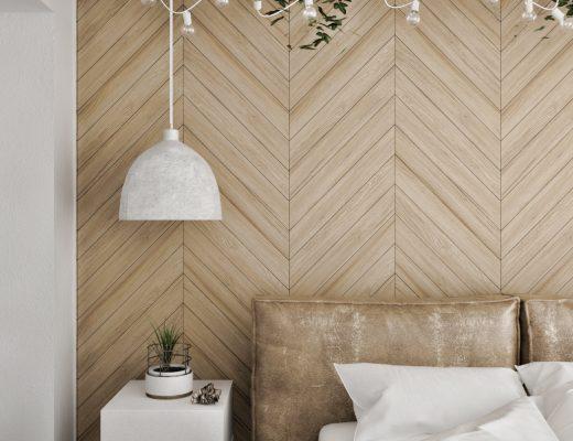 Slaapkamer met betonvloer en visgraat muur