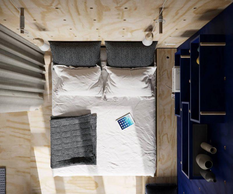 Stoere slaapkamer met een blauwe gaatjesbord muur