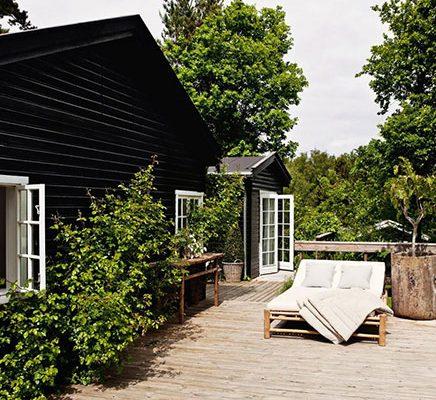 Tuin van zomerhuisje van Tine K