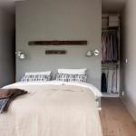 Wand maakt slaapkamer en inloopkast