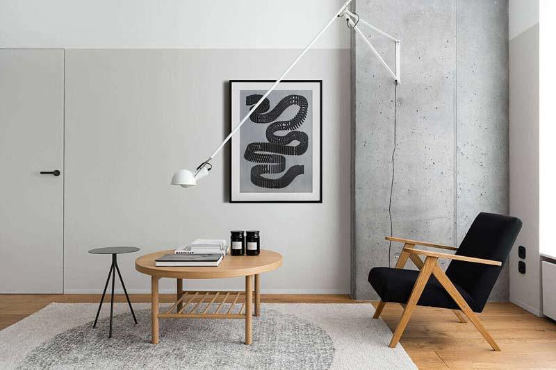 witte flos 265 wandlamp betonnen muur