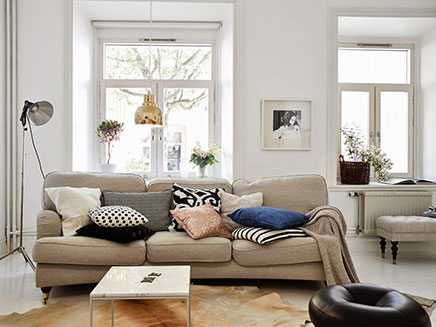 Woonkamer inrichting met vintage zithoek | Inrichting-huis.com