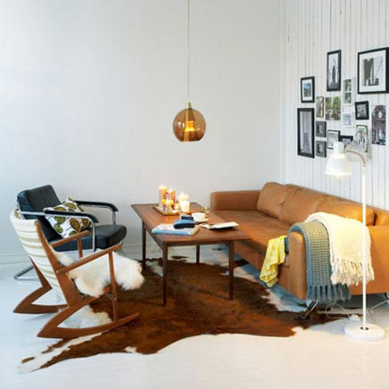 Woonkamer met een vintage zithoekje inrichting for Vintage woonkamer