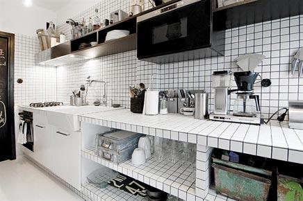 overige zwart in deze keuken zoals enkele stoelen de grote keuken en ...